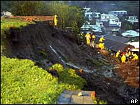 Rescue workers attend a mudslide at a mountain range above Taipei, Taiwan, on 6 October 2007