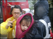 A child is rescued from a home destroyed by a mudslide in Taiwan (06.10)