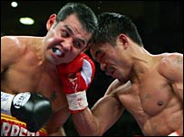 Manny Pacquiao (right)  connects with  Marco Antonio Barrera