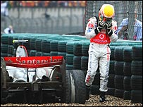 Lewis Hamilton walks away from his stranded car after sliding off the track on his way into the pits at the Chinese Grand Prix