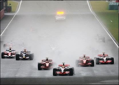 Hamilton gets off to a flier from pole position as rain comes and goes during the early stages of the race