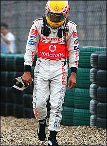 His race over, the 22-year-old trudges disconsolately away from his car to watch the rest of the race from the pit wall