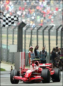 Raikkonen takes the chequered flag to win the Chinese Grand Prix, with Alonso 9.8 seconds further back in second