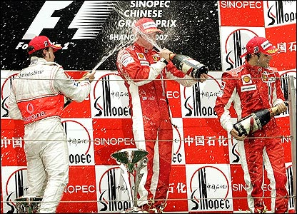 Fernando Alonso, Kimi Raikkonen and Felipe Massa celebrate on the podium after a dramatic race in Shanghai