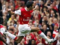 Robin van Persie celebrates putting Arsenal ahead against Sunderland