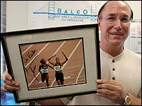 Conte holds up a signed photograph of disgraced sprinter Marion Jones
