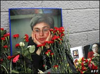 flowers placed in front of a photograph of Anna Politkovskaya