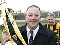 John Coughlin with the Third Division trophy