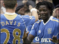 Sean Davis and Benjani celebrate