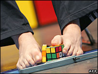 Japanese teen wins rubik, naked men tribes