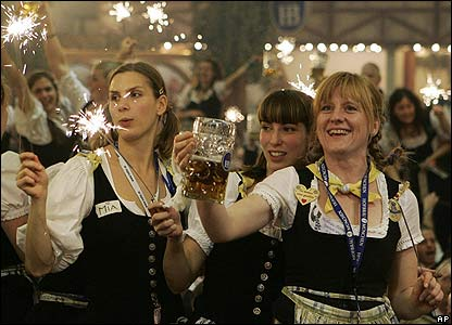 Waitresses celebrate the end of the beer festival Oktoberfest in Munich, southern Germany