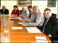Sir Jon Shortridge, sitting on the right hand side of First Minister Rhodri Morgan