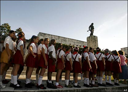 School students stand near a monument to Che Guevara in Santa Clara, Cuba