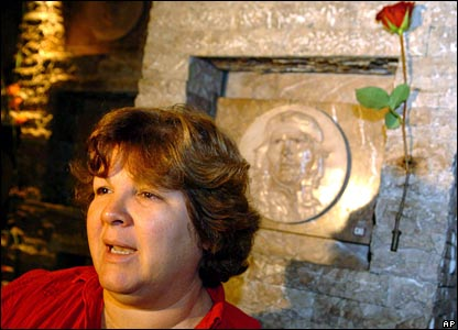 Aleida Guevara, daughter of Che Guevara, stands next to her father's grave during a ceremony in his honour in Santa Clara, Cuba