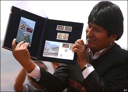 Bolivian President Evo Morales displays a new postal stamp depicting Che Guevara at a ceremony in Vallegrande, Bolivia