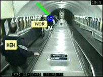 Police officers enter the tube
