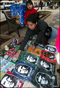 A woman sells Che Guevara memorabilia in Vallegrande, Bolivia