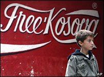Boy in front of Free Kosovo sign