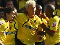 Darius Henderson (centre) is congratulated after scoring for Watford