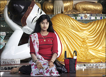 A woman prays at a shrine at Shwedagon Pagoda in Rangoon, Burma