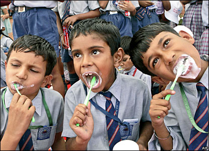 Indian children brush their teeth at a school in New Delhi, India