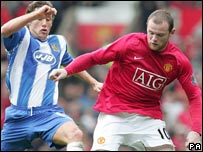 Manchester United's Wayne Rooney and Wigan's Michael Brown