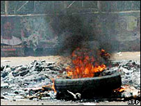 burning tyre during Nigerian election violence (2007)