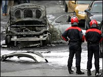 Firefighters view the wreckage of the car which exploded in Bilbao, northern Spain, on 9 October 2007