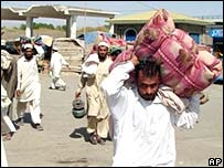 Residents leave North Waziristan's main town, Miranshah, 9 October