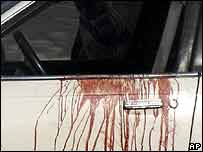 The bloodstained door of the car caught in Tuesday's shooting
