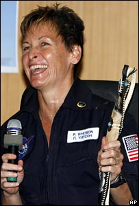 US astronaut Peggy Whitson holding a Kazakh riding whip