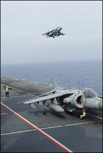 A warplane lands on HMS Illustrious