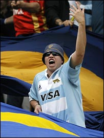 A Boca Juniors fan wears his Argentina rugby shirt