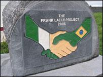 A stone marking Irish-Brazilian friendship on a football field in Gort, Ireland