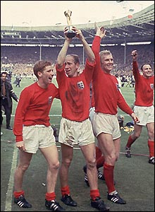 Sir Bobby Charlton (centre) is flanked by Alan Ball (left) and Sir Bobby Moore (right) after England's win over Germany in the 1966 World Cup final