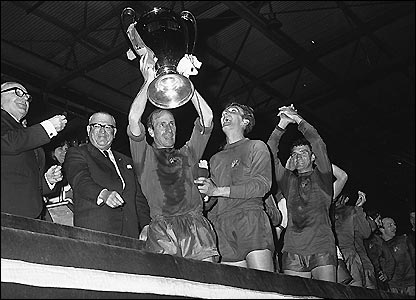 Sir Bobby Charlton celebrates Man Utd's 4-1 win over Benfica in the European Cup