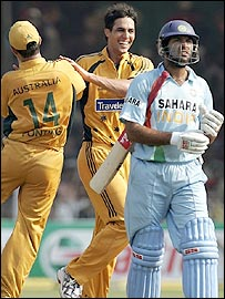 Mitchell Johnson celebrates the dismissal of Yuvraj Singh