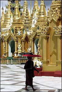 A monk walks at Shwedagon Pagoda in Rangoon