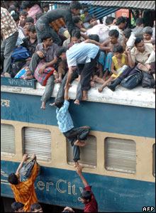 Homebound people crowd to board a passenger train in Dhaka, Bangladesh