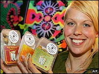 Full Moon store owner Chloe Collette poses with some of magic mushrooms she has for sale in Amsterdam, Netherlands, Thursday Aug. 2, 2007.