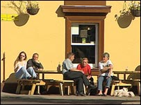 People drinking in the September sunshine