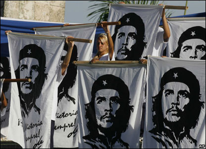 Students hold banners with the image of the late Argentine-born Cuba's revolutionary leader Ernesto 'Che' Guevara