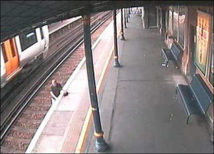 CCTV images of a man trespassing on train tracks