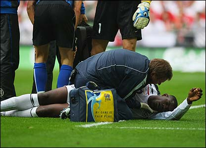 Micah Richards is treated after a clash of heads