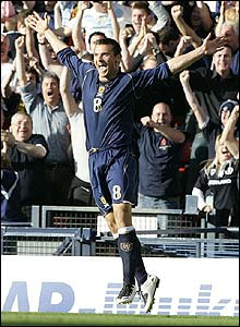 Scotland's Lee McCulloch celebrates scoring the second