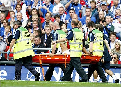 Ashley Cole is stretchered off after suffering an ankle injury