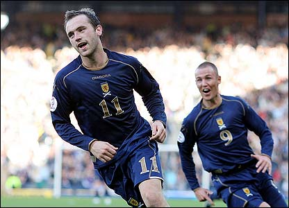 James McFadden celebrates scoring the third for Scotland