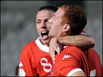 James Collins is congratulated by Wales captain Craig Bellamy