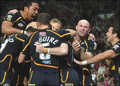 Leeds players celebrate Scott Donald's try at Old Trafford