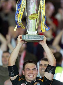 Kevin Sinfield lifts the Grand Final trophy after his team's victory
